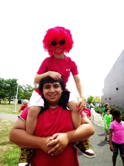 couselor-w-red-hair-kid-theater-camp