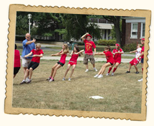 Kids having fun playing Tug of War at summer camp